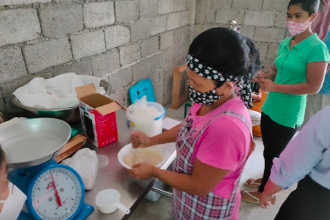 Woman working in the kitchen during the hands-on training.